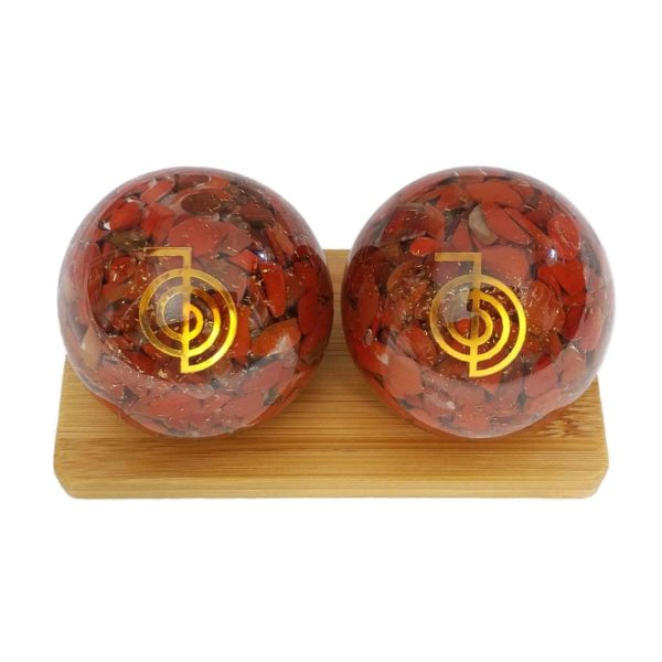 Red jasper orgonite baoding balls on bamboo stand