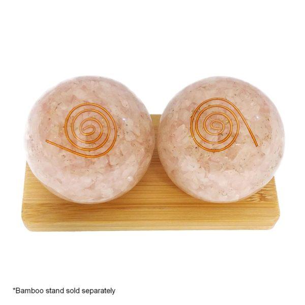 Rose quartz orgonite baoding balls on display stand