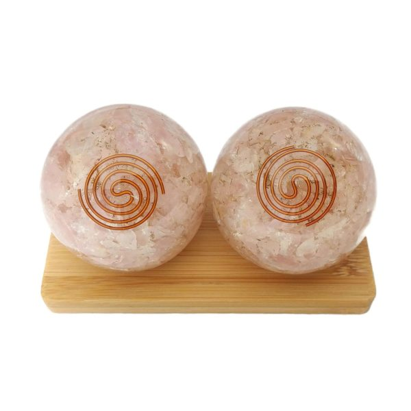 large rose quartz orgonite baoding balls on display stand