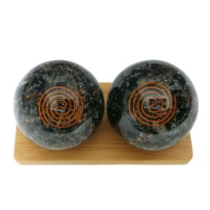 Black tourmaline baoding balls on a display stand