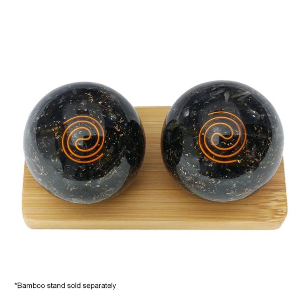 Black tourmaline baoding balls on a display stand