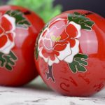 Pair of red cloisonne peony baoding balls