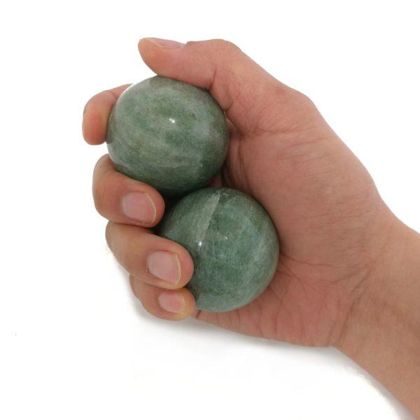 Hand holding large India jade baoding balls