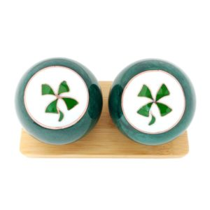 Four Leaf Clover baoding balls on a display stand