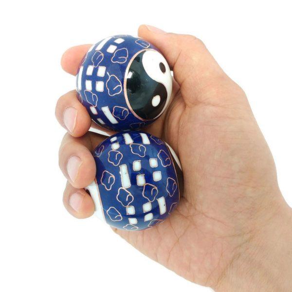 Hand holding large size bagua baoding balls