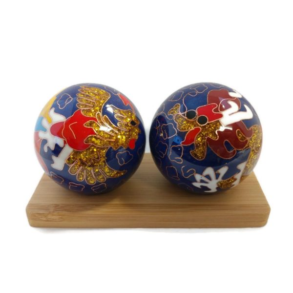 Baoding balls displayed on bamboo stands