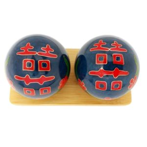 Double happiness baoding balls on a display stand