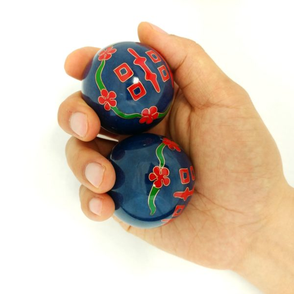 Hand holding large size double happiness baoding balls