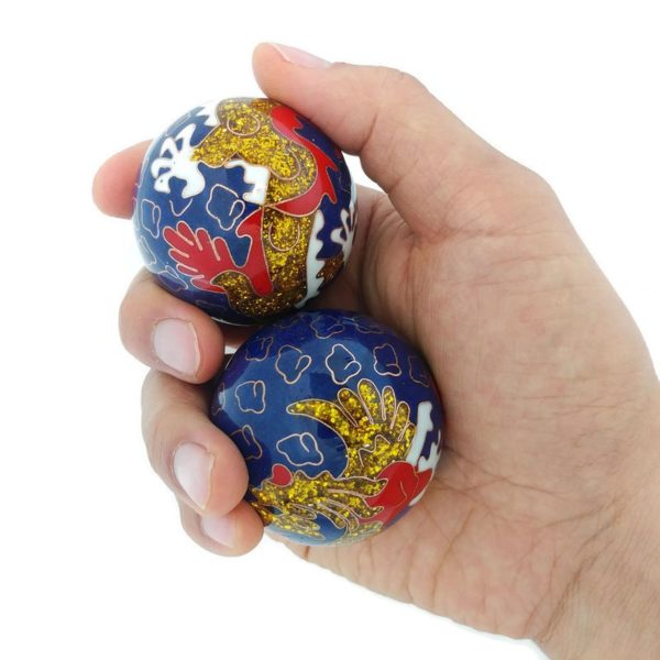 Hand holding large size premium dragon phoenix baoding balls