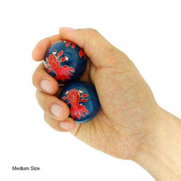 Hand holding medium goldfish baoding balls