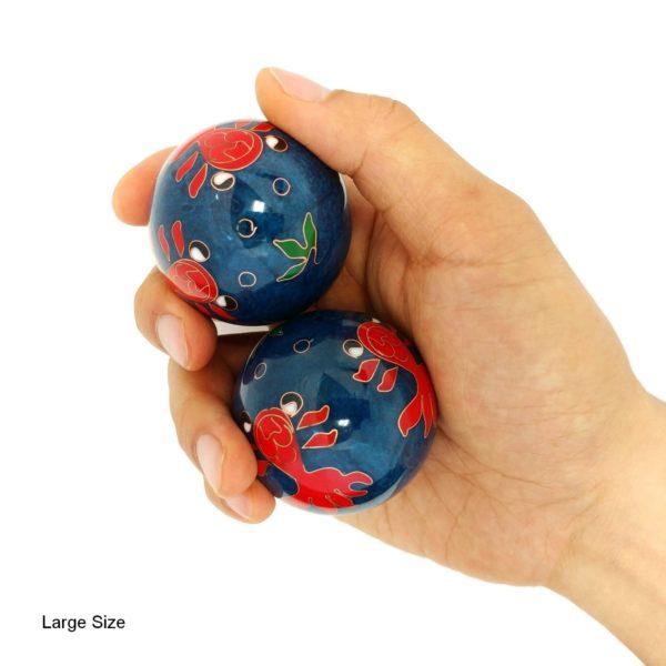 Hand holding large goldfish baoding balls
