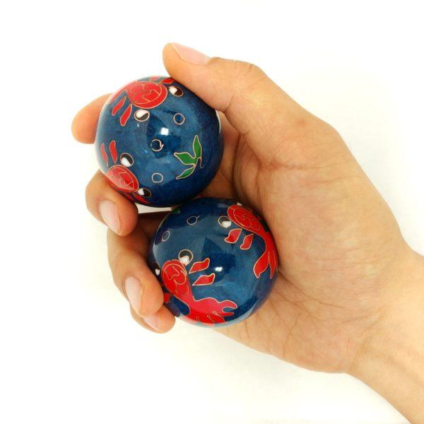 Hand holding large size goldfish baoding balls