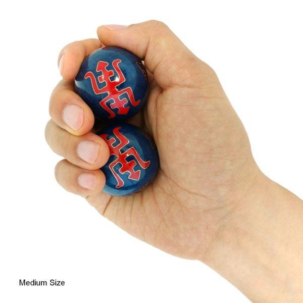 Hand holding medium longevity baoding balls