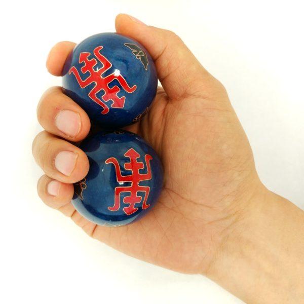 Hand holding large size longevity baoding balls