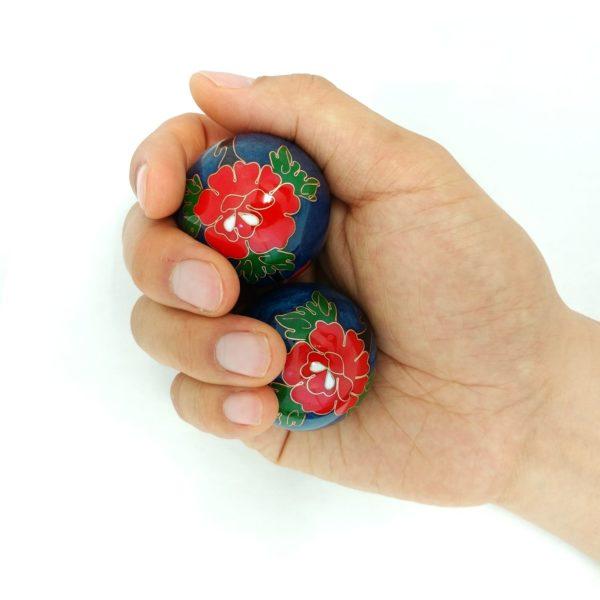 Hand holding medium size peony baoding balls
