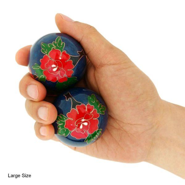 Hand holding large peony baoding balls