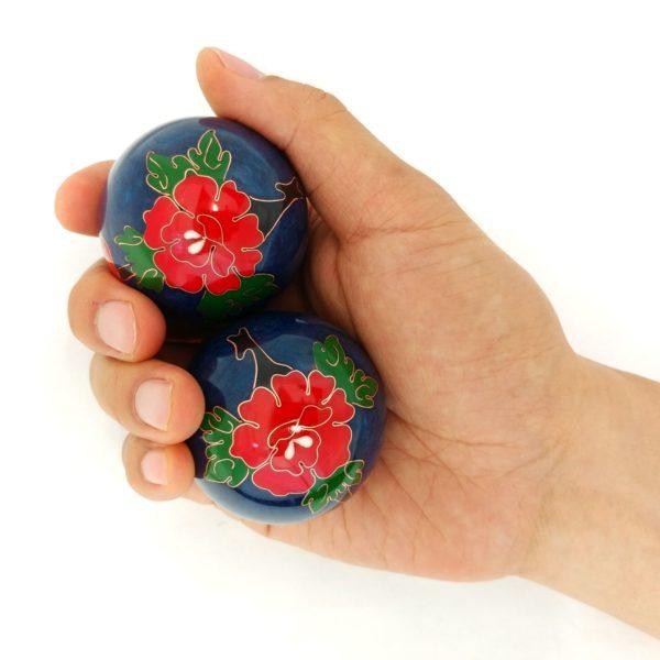 Hand holding large size peony baoding balls