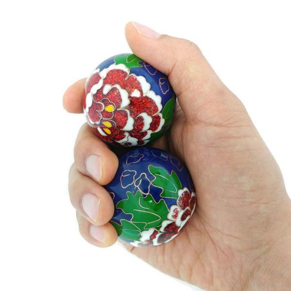Hand holding large size premium peony baoding balls