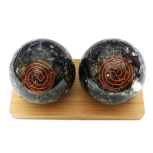 Black obsidian orgonite baoding balls on a display stand