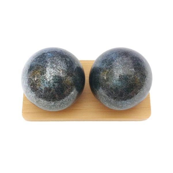 Hematite baoding balls on a display stand