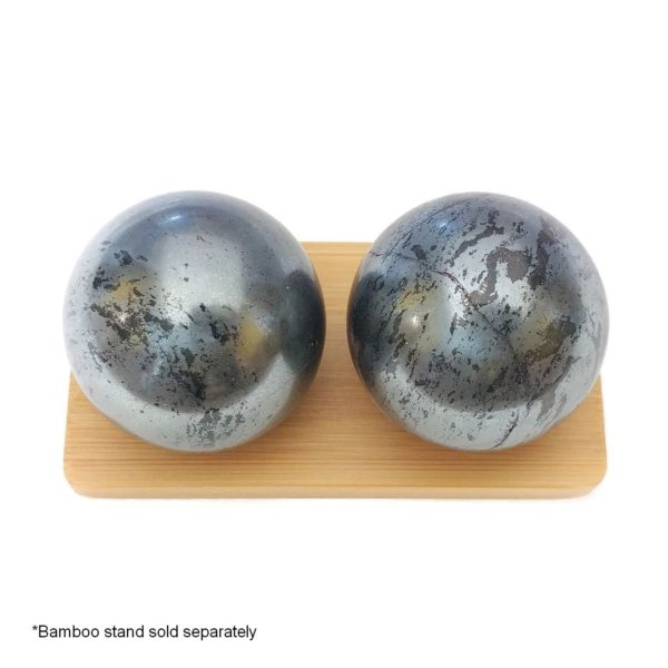 Hematite baoding balls on a display stand