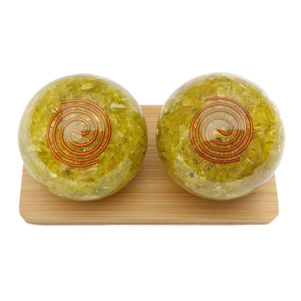 Peridot orgonite baoding balls on a display stand