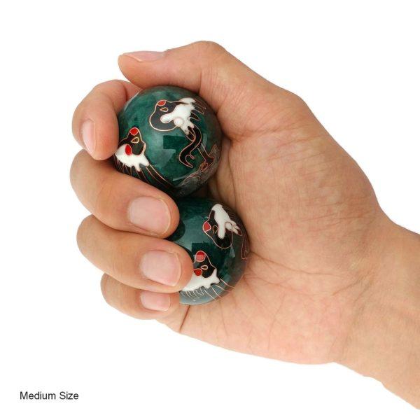 Hand holding crane baoding balls