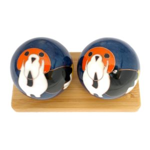 Dog baoding balls on a bamboo display stand