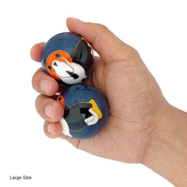 Hand holding large dog baoding balls