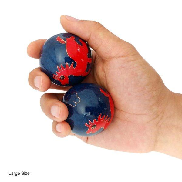 Hand holding horse baoding balls