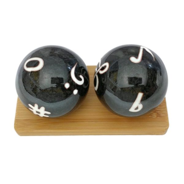 Music symbol baoding balls on a bamboo display stand