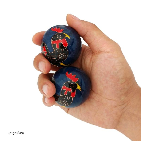 Hand holding large rooster baoding balls