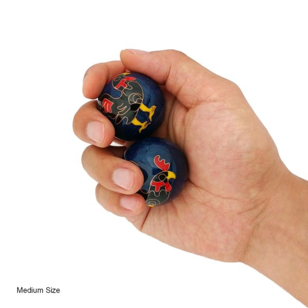 Hand holding medium rooster baoding balls