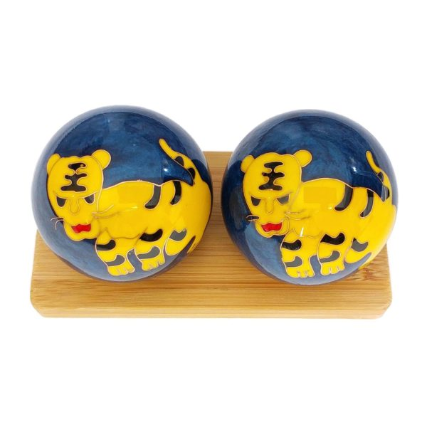 Tiger baoding balls on bamboo display stand