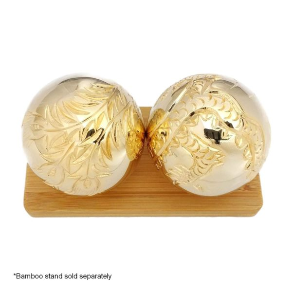 Gold baoding balls on a display stand