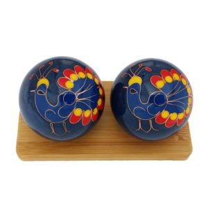 Peacock baoding balls on a bamboo display stand