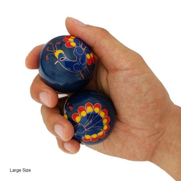 Hand holding large size peacock baoding balls
