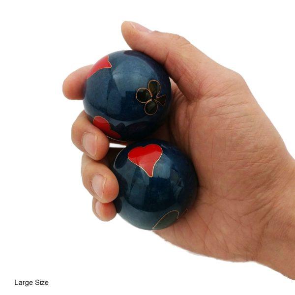 Hand holding large poker baoding balls