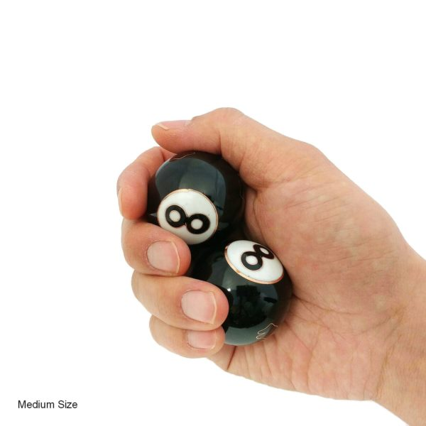 Hand holding medium 8 ball baoding balls