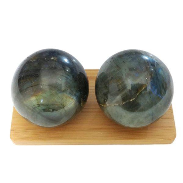 Labradorite baoding balls on a display stand