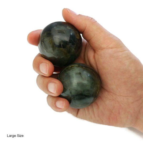 Hand holding large labradorite baoding balls