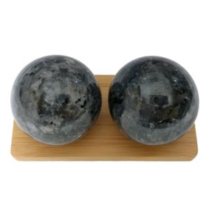 Blue pearl larvikite baoding balls on a display stand