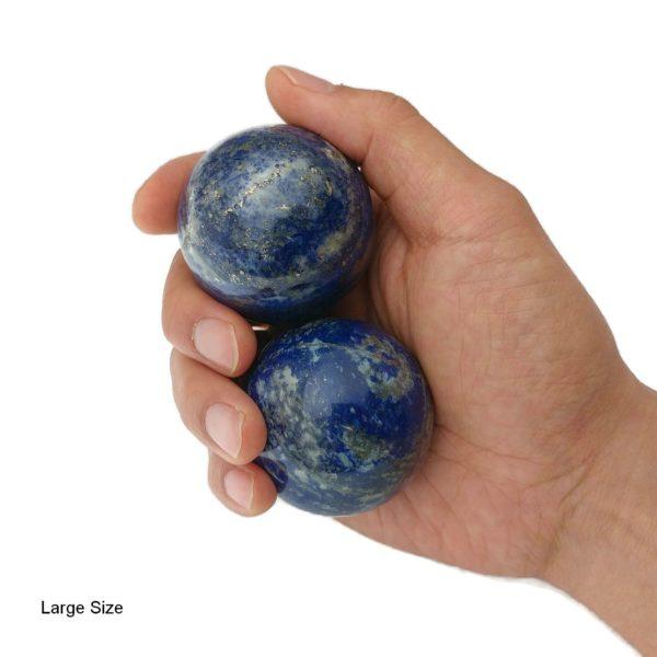 Hand holding large lapis lazuli baoding balls