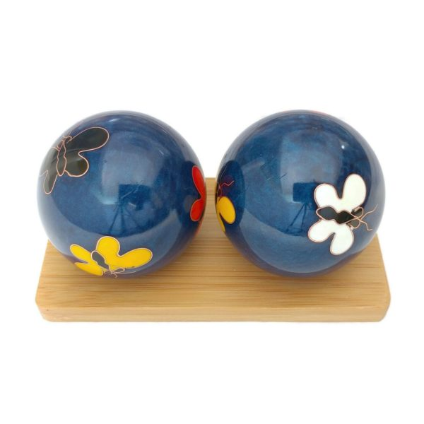 Butteryfly baoding balls on a display stand