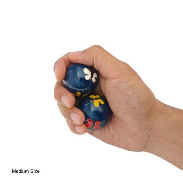 Hand holding medium butterfly baoding balls