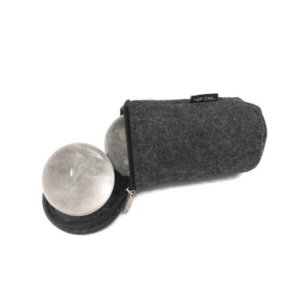 Clear quartz baoding balls in a carry bag
