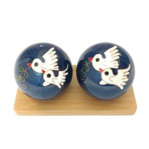 Dove baoding balls on a display stand