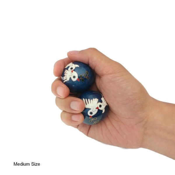 Hand holding medium dove baoding balls