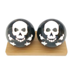 Skull and bones baoding balls on a display stand